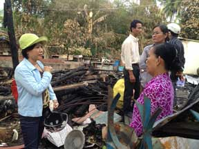 Board member Phuong discusses rebuilding with homeowner
