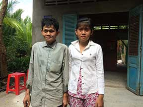Mr. Tu and his daughter Thoa in front of new house