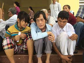 Three blind people waiting for rice