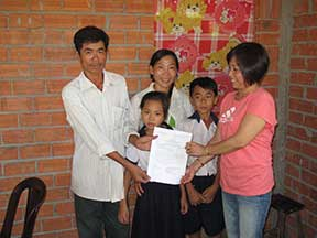 Phuong hands the deed to the new homeowner